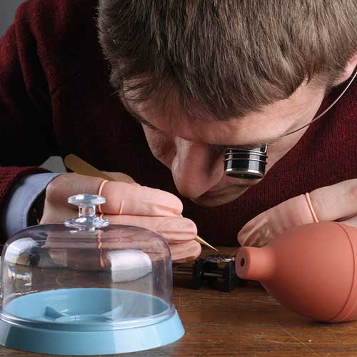 Appentice watchmaker Euan Fairholm at the bench.