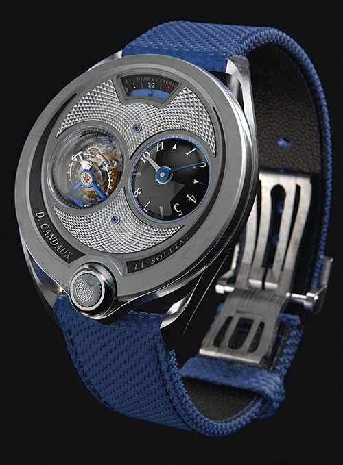 David Candaux exhibited his 1740 'The First 8' watch featuring a 30-degree inclined flying tourbillon running on ceramic ball-bearings. Just as the dial, the movement is inclined (wheels and bridges), highlighting their decoration and accentuating the reflection of light on their superb angles. The plates and bridges are made from untreated titanium. The decoration is 'Côtes du Solliat', a new  form of stripes devised by David Candaux. The case has a sleek asymmetric design with a secret retractable crown located at 6 o'clock.
