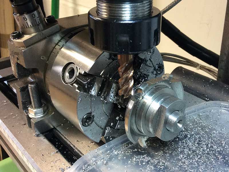 Figure 11. Milling the outside of the watch case.