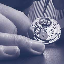 Watchmaker Chris Roussias at work.